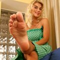Blonde showing her shaped meaty soles