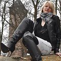 Franzi wearing leather overknee boots outside