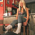 Girl in white boots trampling her slave