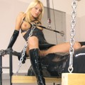 Booted Mistress sitting on tied slave