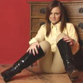 Sarah Young posing in riding boots