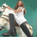 Princess Fatale riding on rocking horse