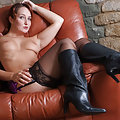 Sammy B is wearing some purple lingerie and horny short leather boots