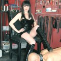 Mistress with a slave under her throne