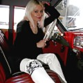 Cute booted Larissa posing in classic cars