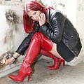 Manuela wearing red oveknee boots