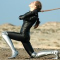 Princess Fatale in black catsuit and silver boots