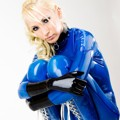 Susan Wayland in blue catsuit and transparent boots