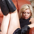 Babe in leather gloves & boots shows pussy